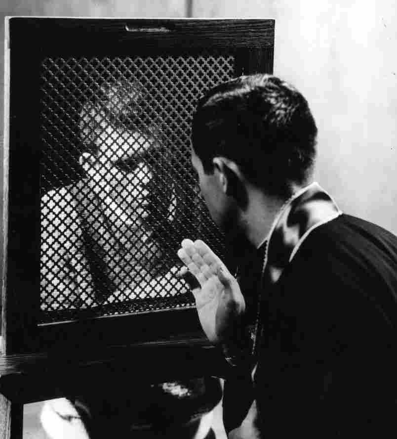 A priest hearing a confession, circa 1950. (Photo by Three Lions/Getty Images)