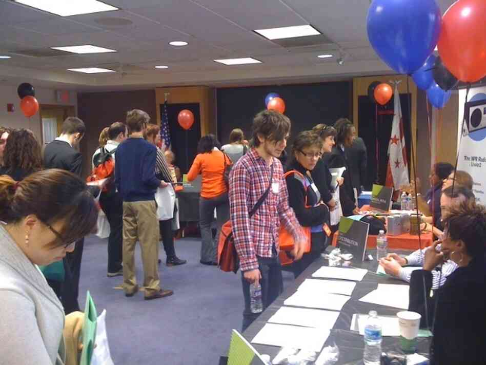 Prospective interns visit tables representing various NPR departments.