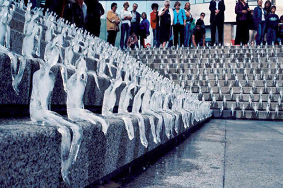 "Hundreds of ice figures melt in a plaza in Porto, Portugal as part of the Minimum Monument ""urban intervention"" in 2006."