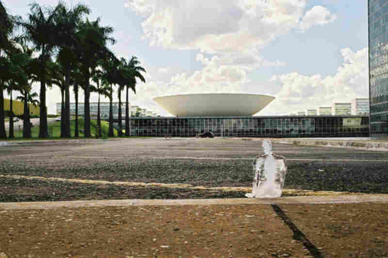 A lone ice figure melts outside of the National Congress in Brasilia, Brazil, in 2003.