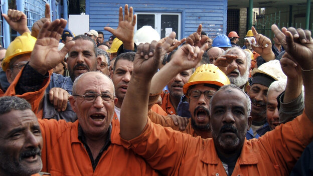 Suez Canal Company workers protest as they began an open-ended strike in front of the company's headquarters Wednesday.