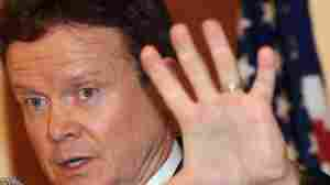 Sen. Jim Webb gestures while answering a question during a press conference in Hanoi on Aug. 19, 2009.