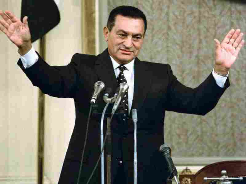 Mubarak waves to parliament on Oct. 12, 1993, after being sworn in for a third six-year term as president. He had promised to serve only two terms.