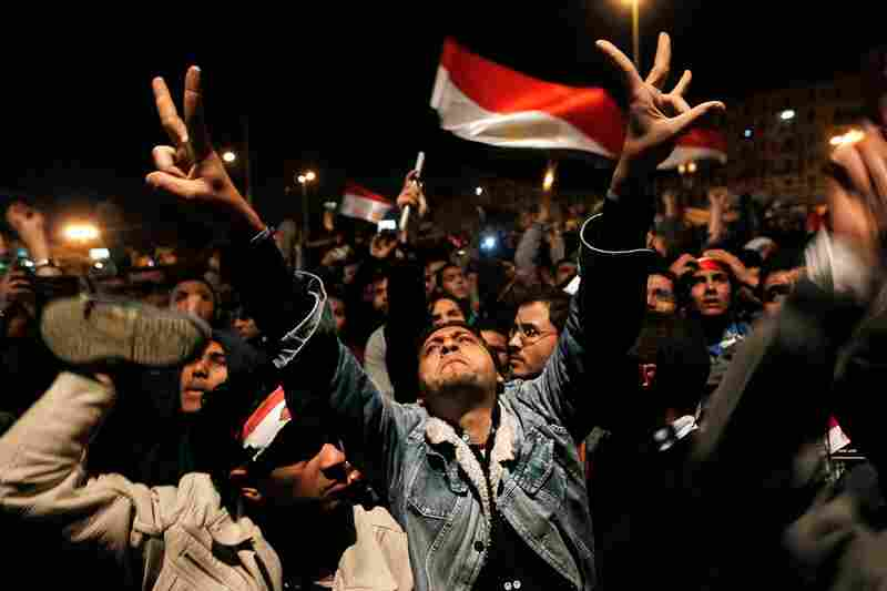 Protesters react in Cairo's Tahrir Square after Egyptian President Hosni Mubarak addressed the nation on Thursday, Feb. 10. After rumors that he would step down, Mubarak said he had given some powers to his vice president but would not resign.