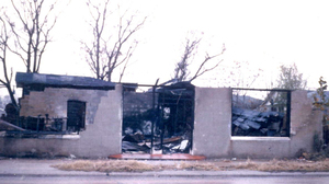 The shoe store owned by Frank Morris after it was set ablaze in December 1964.