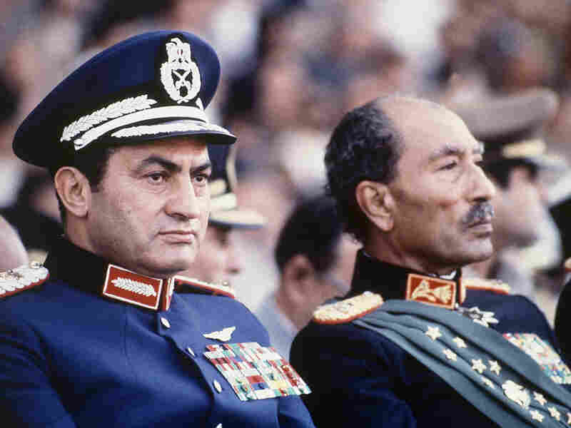 Egyptian President Anwar Sadat (right) and Mubarak are seen on the reviewing stand during a military parade on Oct. 6, 1981, just before Sadat was gunned down.