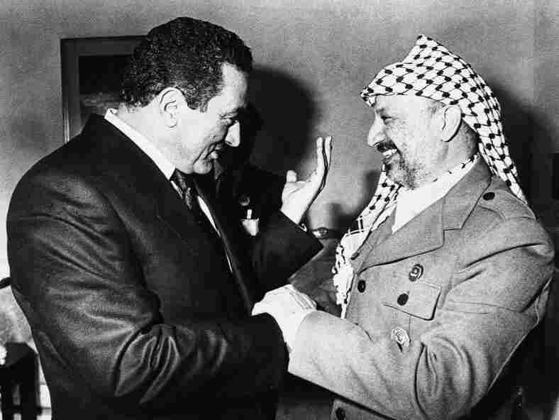 Mubarak speaks with Palestine Liberation Organization leader Yasser Arafat in Kuwait at the sidelines of the 5th Islamic Summit on Jan. 27, 1987. The Egyptian president maintained peaceful relations with Israel during difficult times.