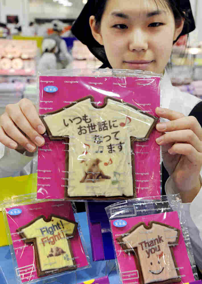 "An employee at Tokyo store Message de Rose displays Valentine's Day chocolates at the Takashimaya department store's ""Amour du Chocolat"" event."