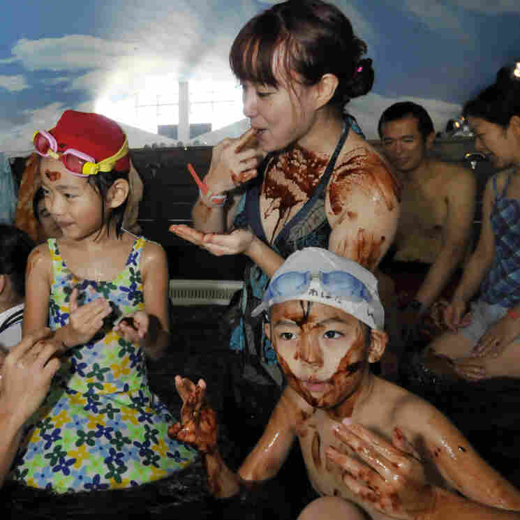 "A family enjoys a dip in the ""chocolate spa"" at the Hakone Yunessun spa resort in Hakone, 60 miles west of Tokyo. Each year, the Yunessun offers the special spa to mark Valentine's Day."