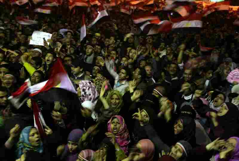 Tens of thousands of Egyptian anti-government protesters crowd in Tahrir Square on Thursday in anticipation of Mubarak's address to the nation.