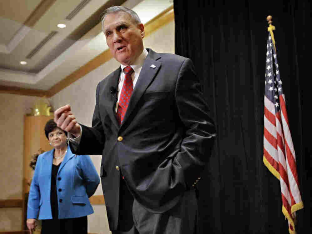 Sen. Jon Kyl in Phoenix announcing his retirement as wife, Caryll Kyle, listens, Feb. 10, 2011.