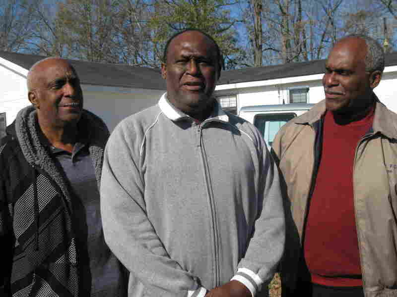 From left to right: Willis, Robert and James Lee. The three brothers are the sons of the Rev. Robert Lee Jr., who was  one of the few to visit Frank Morris in the hospital after the shoe store was set on fire.