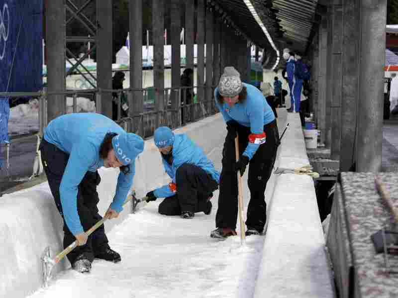 Staff make adjustments to the luge track at the 2010 Winter Games in Whistler, British Columbia, on Feb. 12, 2010.