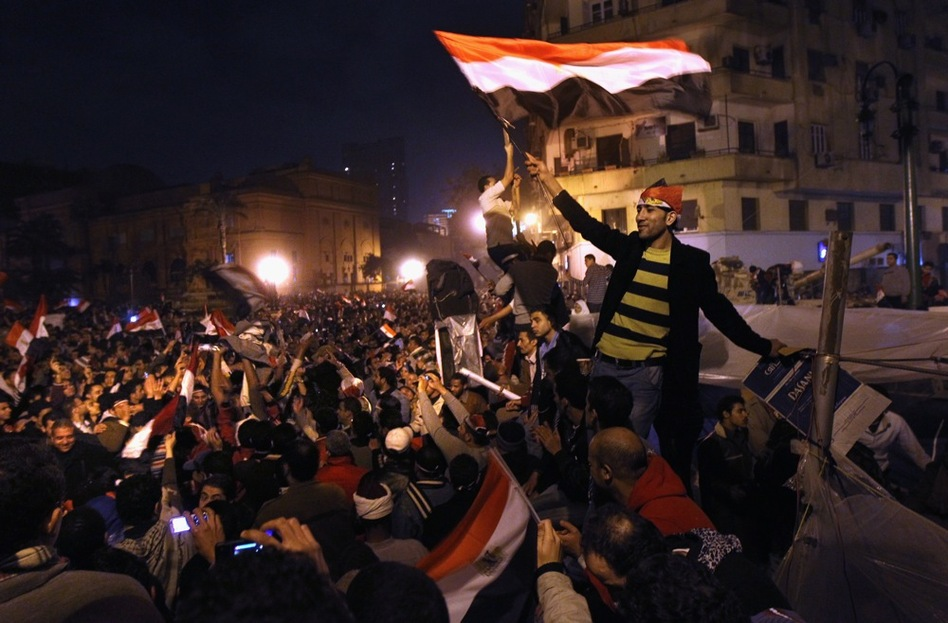 Egyptians celebrate in Tahrir Square after hearing the news of the resignation of President Hosni Mubarak on Friday.  (Getty Images)