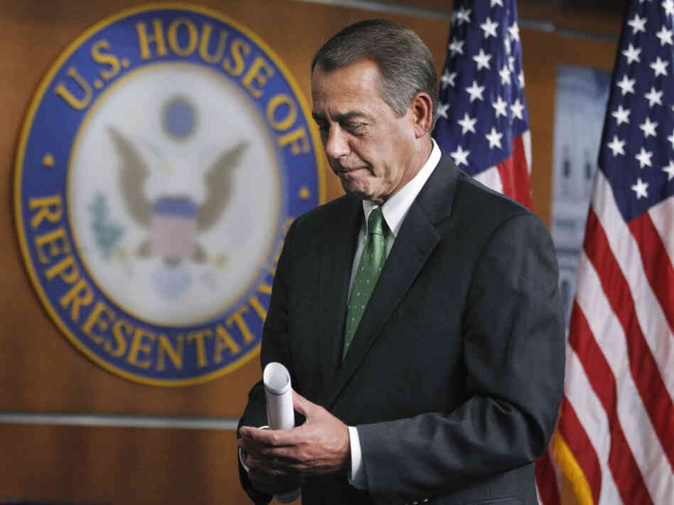 House Speaker John Boehner leaves a Capitol Hill news conference, Thursday, Feb. 10, 2011.