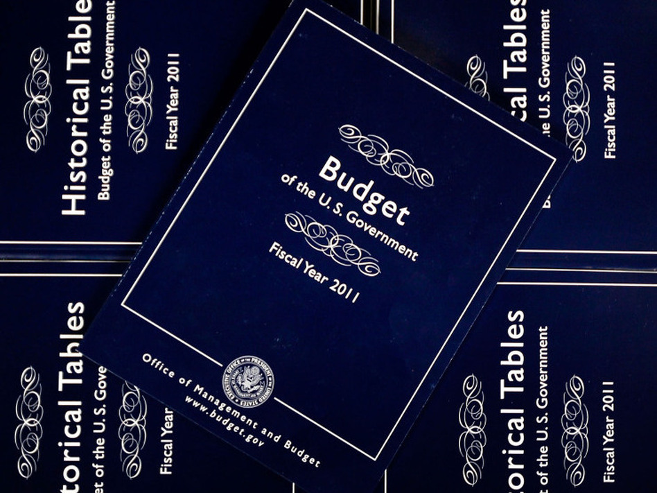 President Obama's budget is expected to include plans for spending on new initiatives and dramatically cutting some programs. Copies of Obama's fiscal 2011 budget are seen above.