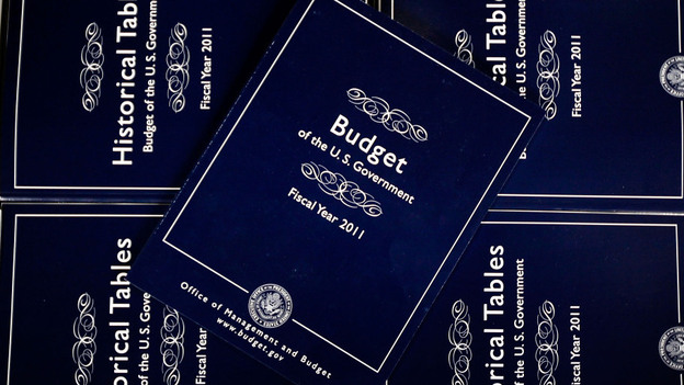 President Obama's budget is expected to include plans for spending on new initiatives and dramatically cutting some programs. Copies of Obama's fiscal 2011 budget are seen above. (Getty Images)