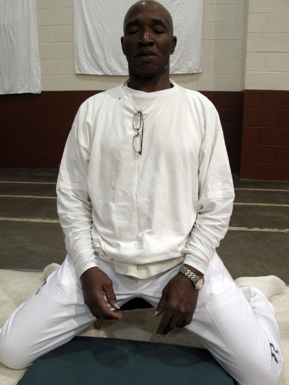 "Convicted murderer Johnny Mack Young in the meditation stance he keeps for nearly 10 hours a day during the 10-day silent meditation course. Officials say the meditation program is reducing violence at Alabama's highest security lockup. ""It changed my life,"" Young says."