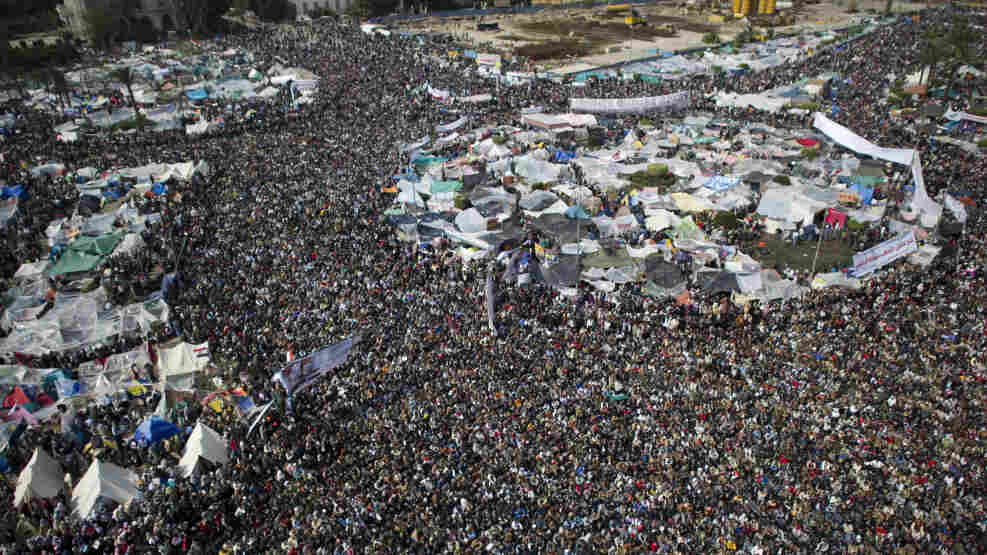Egyptian anti-goverment demonstrators flood Cairo's landmark Tahrir Square early Friday.