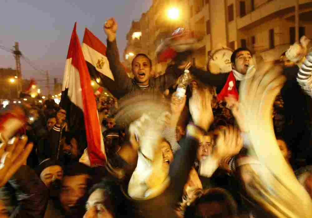 Egyptian anti-government protesters celebrate at Cairo's Tahrir Square after President Hosni Mubarak stepped down on February 11.