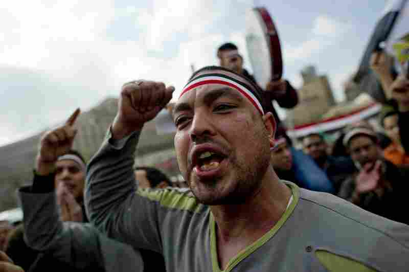 Egyptian anti-goverment demonstrators shout in Cairo's Tahrir Square on Friday, the 18th consecutive day of protests demanding the resignation of Mubarak.