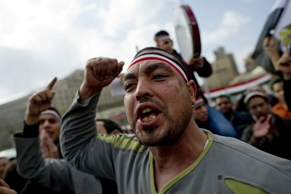 Egyptian anti-goverment demonstrators shout in Cairo's Tahrir Square on Friday, the 18th consecutive day of protests demanding the resignation of Mubarak.  (AFP/Getty Images)