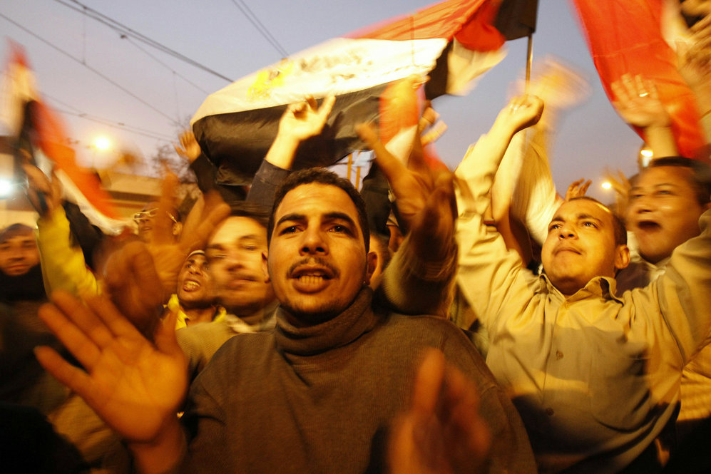 "Demonstrators rejoice in Tahrir Square. ""We are emancipating 85 million people who have been repressed for decades,"" said Nobel Peace Prize laureate Mohamed ElBaradei."