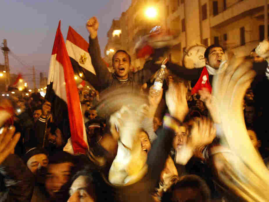 Egyptian anti-government protesters celebrate outside the presidential palace in Cairo, Feb. 11, 2011.