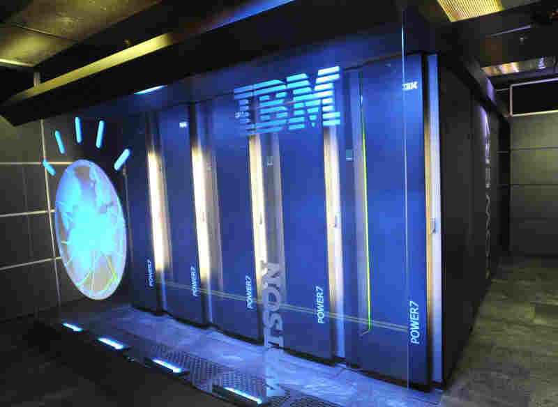 Watson is made up of 10 refrigerator-sized racks of computers. It has around a million books in its memory, and it's around 32,000 times faster than a laptop.