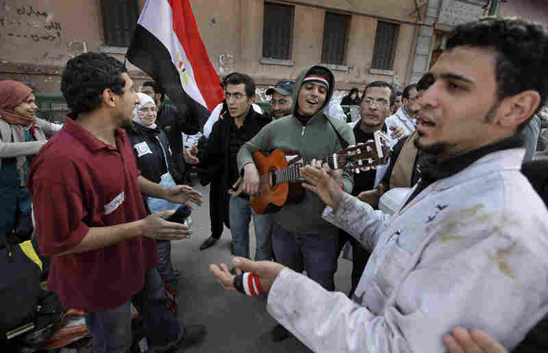 Protesters sing by a field medical clinic near the barricades in Tahrir Square.