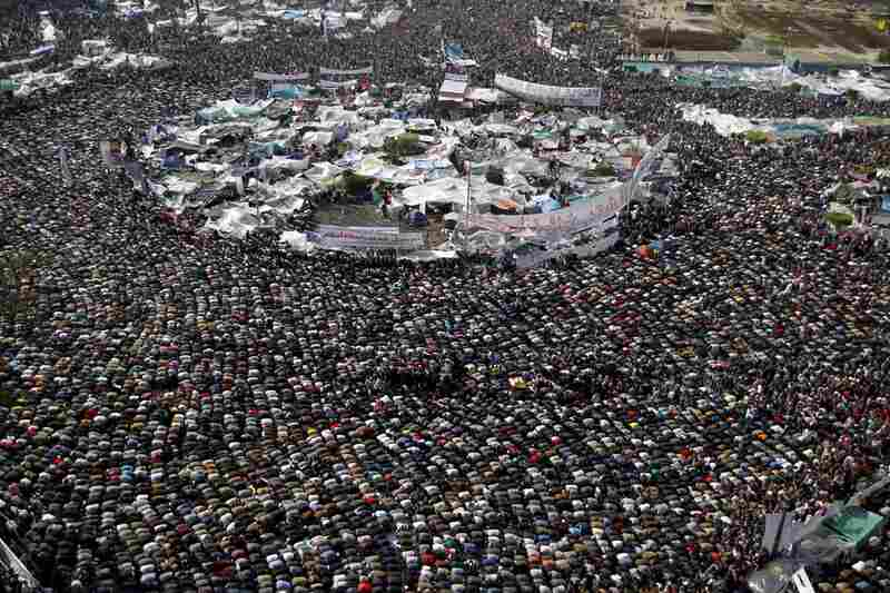 Protesters take a break for prayer amid the protests in Tahrir Square on Friday.