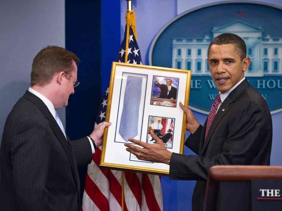 President Obama returns Press Secretary Robert Gibbs necktie, February 11, 2011.