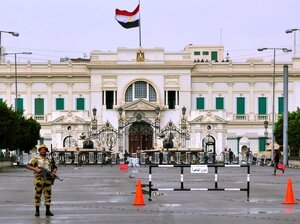 Egyptian soldiers stand guard outside the Abdin Presidential Palace in central Cairo on Feb. 10, the 17th day of protests calling for the ouster of President Hosni Mubarak. Mubarak resigned shortly after.