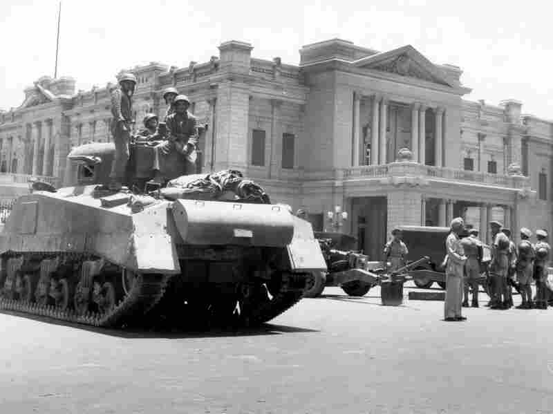 During a coup d'etat led by General Muhammed Naguib,  Egyptian army tanks and field guns are drawn up in front of the royal  Abdin Palace, in Cairo, on July 26, 1952. Appointed Premier Ali  Maher Pasha issued an ultimatum to King Farouk I, forcing the Egyptian monarch  to abdicate.