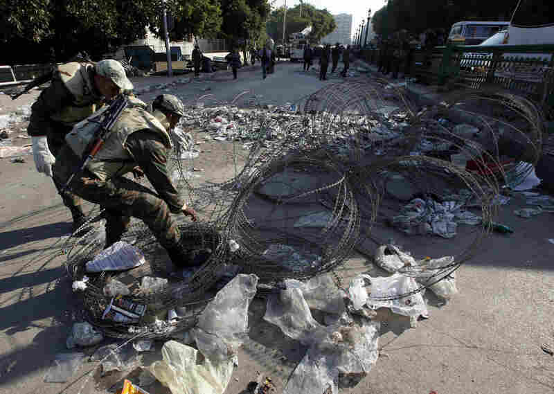 Soldiers remove barbed wire at one of the main entrances to Tahrir Square.