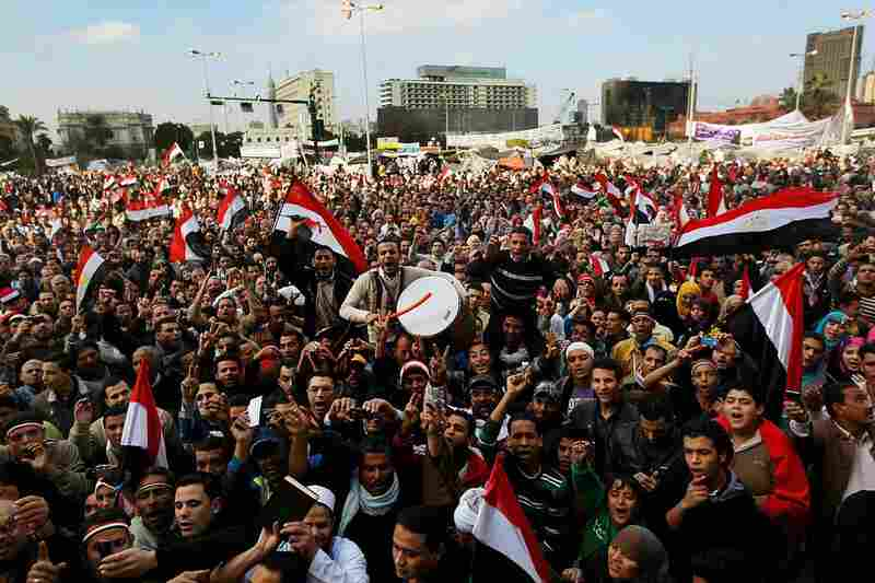 Egyptians celebrate Mubarak's resignation.