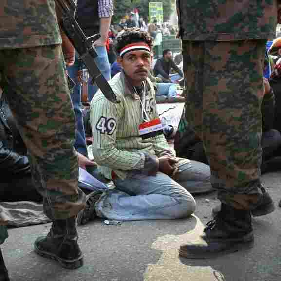 Egyptians stage a sit-in after the army ordered their encampments torn down in Tahrir Square on Sunday.