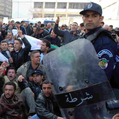 Protesters gather in front of police officers during a demonstration in Algiers, Algeria, on Saturday.