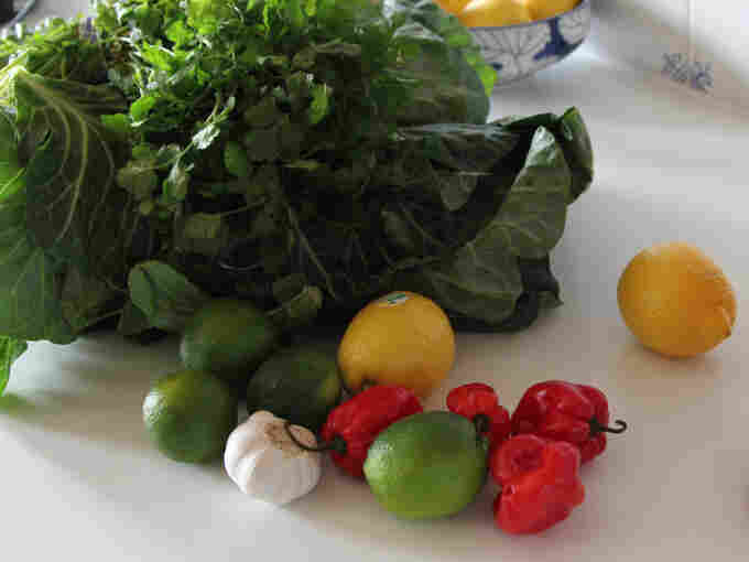 The greens are accompanied by a simple hot sauce of lemon and lime juice with chopped cilantro, garlic and chilies.
