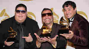 Grupo Fantasma poses with their award during the 53nd annual Grammy Awards in Los Angeles, California on January 31, 2010. They won for Best Latin Rock, Alternative Or Urban Album. AFP PHOTO / GABRIEL BOUYS (Photo credit should read GABRIEL BOUYS/AFP/Getty Images)