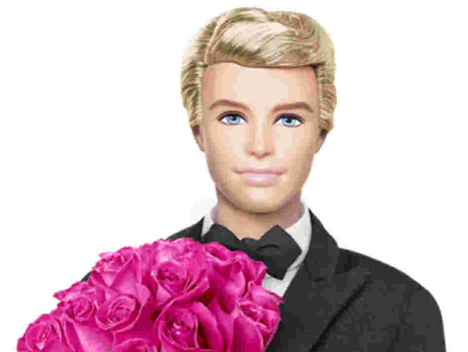 The 2011 Ken dressed in a tuxedo with a bouquet of roses.