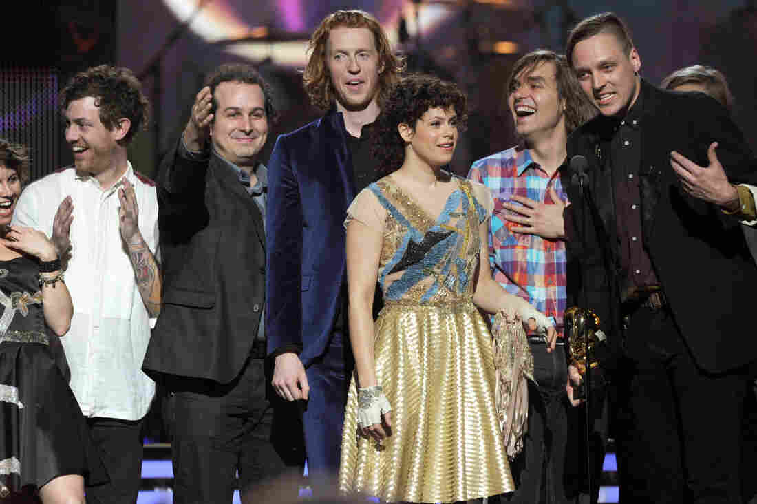 Arcade Fire accepts the Album of the Year Award for The Suburbs onstage during The 53rd Annual Grammy Awards.