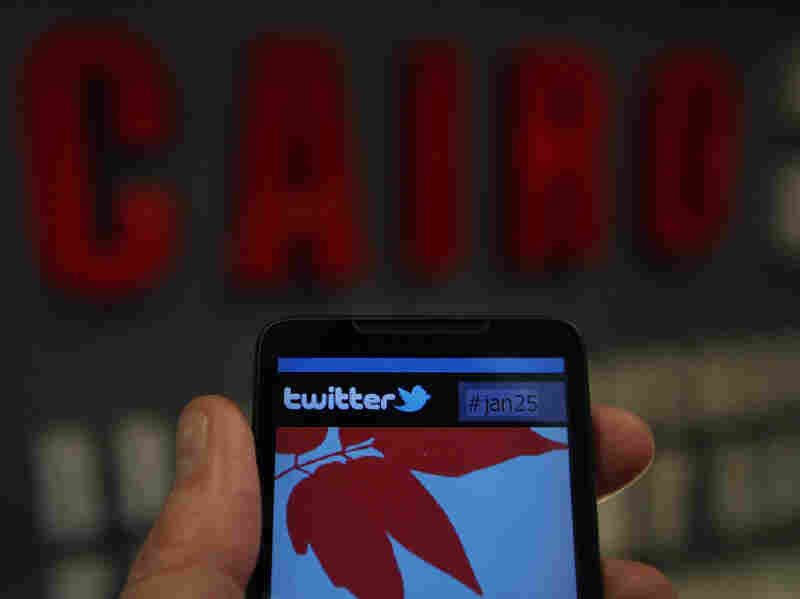 In this photo illustration, a smartphone displays a page from Twitter in Cairo, Egypt. People across Egypt used Twitter and other social media to mass organize protests with the searchable hashtag, #jan25.