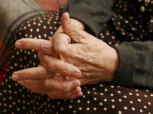 An elderly woman's hands.