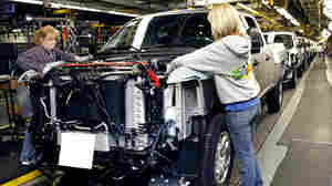 Workers on a Chevrolet pickup truck assembly line in Flint, Mich., on Jan. 24, 2011.
