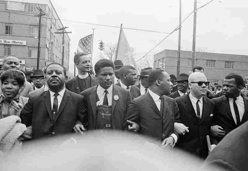 John Lewis (right) joins a march to the Montgomery, Ala., courthouse with the Rev. Martin Luther King Jr. (third from right) and his aides, March 17, 1965.