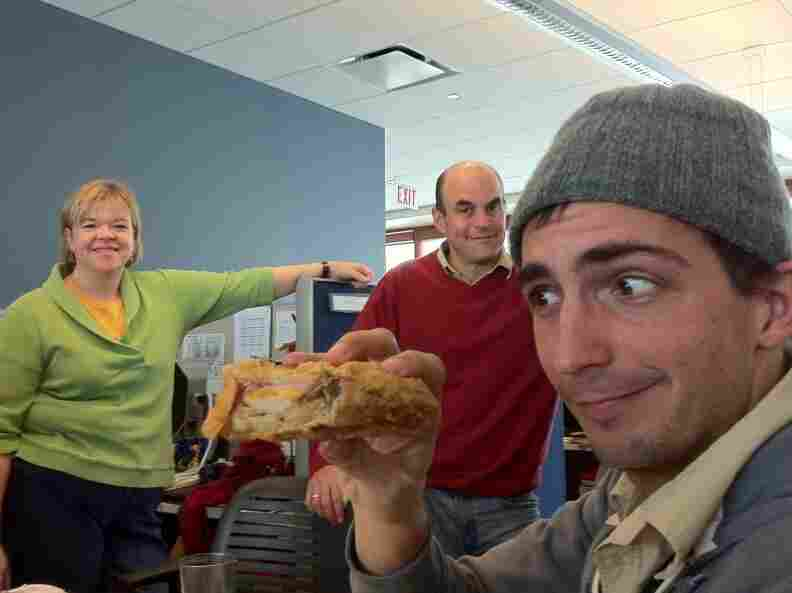 "Ian holds the bread, or what some people call ""a month's worth of food."""
