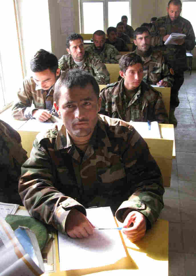 Soldiers in the Afghan army take turns reading basic sentences aloud in class.  Officials say literacy courses provide essential skills and may cut down on  corruption.  An estimated 70 percent to 90 percent of Afghan soldiers and police are illiterate.