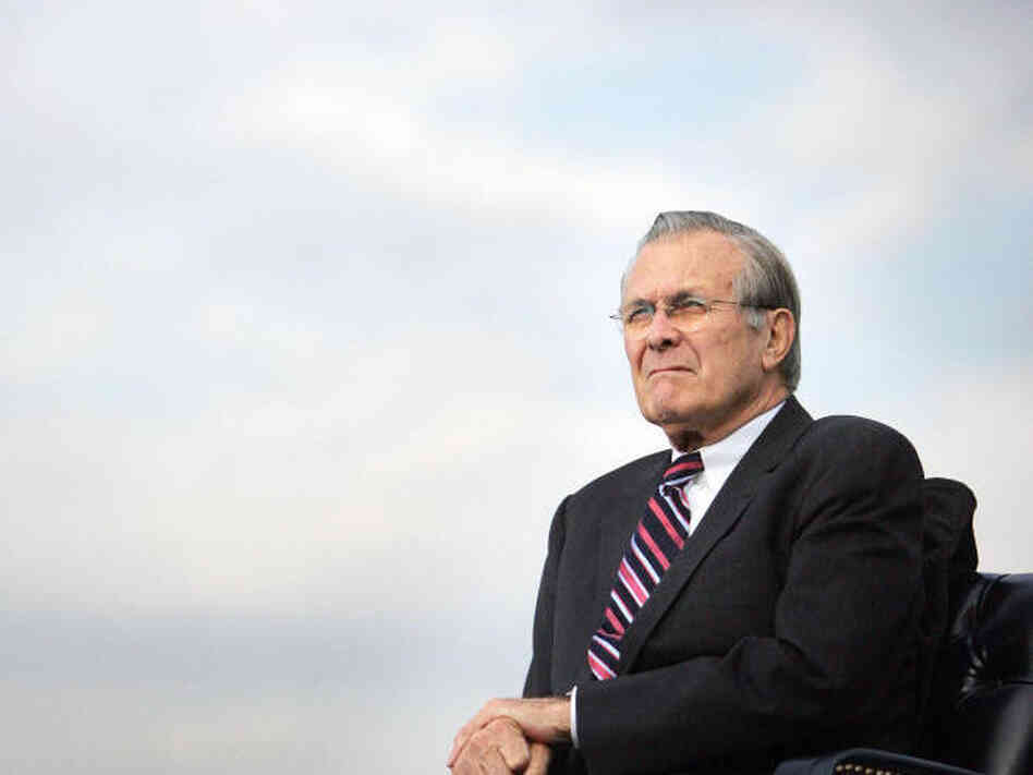 Outgoing Secretary of Defense Donald Rumsfeld listens during an Armed Forces Full Honor Review in his honor in 2006. Rumsfeld came out with a memoir last week titled Known and Unknown.