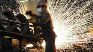 Sparks flew at a steel mill in Hefei, in eastern China's Anhui province, on Dec. 23, 2010.